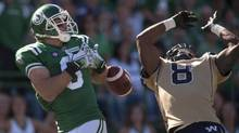 Winnipeg Blue Bombers defensive back Chris Randle (right) is able to block a pass intended for Saskatchewan Roughriders wide receiver Rob Bagg during the second quarter of CFL action in Regina, Sask., Sunday, August 31, 2014. (Liam Richards/THE CANADIAN PRESS)