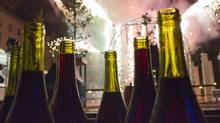 Bottles of Beaujolais nouveau are seen during a fireworks display for the official launch of the 2010 vintage in the centre of Lyon, France, on Nov. 18, 2010. (ROBERT PRATTA/ROBERT PRATTA/REUTERS)