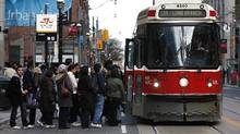 Customers board a TTC streetcar at Yonge and Queen Streets in Toronto on Nov. 28, 2011. Toronto Mayor Rob Ford announced the 2012 budget on Monday which includes a proposed 10-cent hike in TTC fares. (Deborah Baic/The Globe and Mail/Deborah Baic/The Globe and Mail)