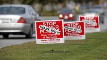 Signs near the site of the proposed power plant in Oakville Oct 15, 2010. (Moe Doiron/The Globe and Mail)/Moe Doiron/The Globe and Mail))