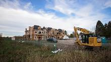 A mansion is under construction in Richmond, B.C., on land that could be used for farming. (Ben Nelms/The Globe and Mail)