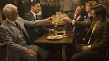 "This image released by AMC shows, from left, John Slattery as Roger Sterling, Jon Hamm as Don Draper, Vincent Kartheiser as Pete Campbell, Christina Hendricks as Joan Harris and Kevin Rahm as Ted Chaough, in a scene from the final season of ""Mad Men."" (Justina Mintz/THE ASSOCIATED PRESS)"
