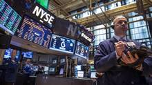 Traders work on the floor of the New York Stock Exchange April 24, 2014. (BRENDAN MCDERMID/REUTERS)