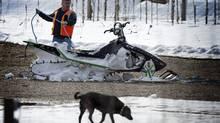 One of the damaged snowmobiles damaged in a weekend avalanche is retrieved on March 14, 2010 near Revelstoke, B.C. (JOHN LEHMANN/John Lehmann/The Globe and Mail)