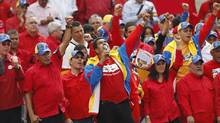 Venezuela's acting President Nicolas Maduro (C) gestures to supporters during a rally outside the national election board in Caracas March 11, 2013. (TOMAS BRAVO/REUTERS)