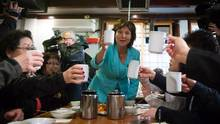 Liberal Leader Christy Clark toasts after serving tea to supporters during a campaign stop at a Korean restaurant in Coquitlam, B.C., on Wednesday April 12, 2017. A provincial election will be held on May 9. (DARRYL DYCK/THE CANADIAN PRESS)