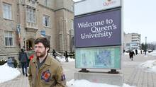 A student walks on the Queen's University campus in Kingston on Feb. 13, 2013. (LARS HAGBERG FOR THE GLOBE AND MAIL)
