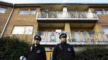 "Police stand guard in front of a property in Lambeth, south London Nov. 23, 2013. Three women enslaved in London for 30 years appeared to have been part of a cult and bound to their captors by ""invisible handcuffs"" through beatings and brainwashing, police said on Saturday. (LUKE MACGREGOR/REUTERS)"