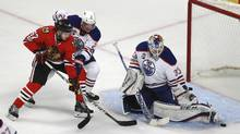 Edmonton Oilers goalie Cam Talbot (33) stops a shot by Chicago Blackhawks centre Tanner Kero (67) as Oilers defenceman Andrej Sekera (2) pressures during the second period of an NHL hockey game Saturday, Feb. 18, 2017, in Chicago. (Jeff Haynes/AP)