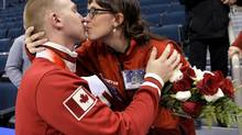 Skip Brad Jacobs kisses his wife Shawna after his win over Team Morris during the men's final at the Roar of the Rings Canadian Olympic Curling Trials in Winnipeg, December 8, 2013. (FRED GREENSLADE/REUTERS)