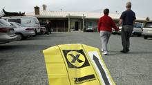 A couple walks up to a polling station near Sidney, B.C, iin the federal riding of Saanich-Gulf Islands on Oct. 14, 2008. (Deddeda Stemler/Deddeda Stemler for The Globe and Mail)