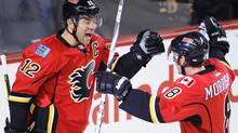Calgary Flames' Jarome Iginla (L) celebrates his goal with teammate Brendan Morrison during the first period of their NHL hockey game against the Carolina Hurricanes in Calgary, Alberta December 6, 2011. REUTERS/Todd Korol (Todd Korol/Reuters)