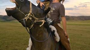Rupert Isaacson and son Rowan found healing in riding and rituals on the steppe.