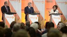 Niki Ashton, right, speaks as Guy Caron, left, and Charlie Angus look on during the first debate of the federal NDP leadership race, in Ottawa on Sunday, March 12. (Justin Tang/The Canadian Press)