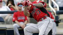 Canada's Brett Lawrie is hit by a pitch during an exhibition spring training baseball game against the Milwaukee Brewers (Morry Gash/The Associated Press)