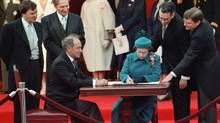 Queen Elizabeth II signs Canada's constitutional proclamation in Ottawa on April 17, 1982 as Prime Minister Pierre Trudeau looks on. The Charter of Rights and Freedoms has caused no end of squabbles among Canadians. (RON POLING/Ron Poling/The Canadian Press)