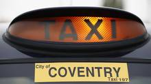 A sign is illuminated on a taxi parked near the London Taxi Company in Coventry, central England October 22, 2012. REUTERS/Darren Staples (BRITAIN - Tags: BUSINESS POLITICS TRANSPORT) (DARREN STAPLES/REUTERS)