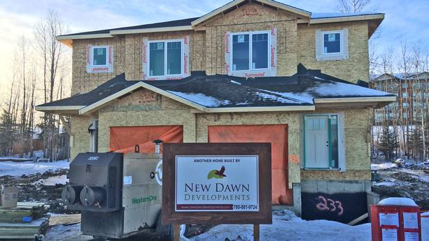 Insurance claim chaos slows fort mcmurray rebuild the for Insurance for home under construction
