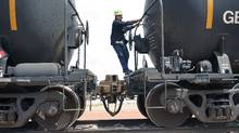 A worker climbs off a crude oil train after setting the handbrake at the Eighty-Eight Oil LLC's transloading facility in Ft. Laramie, Wyoming on July 15, 2014. The U.S. Department of Transportation has released extensive draft rules for shipping crude oil by rail, including slower-speed requirements that industry executives warn could cause major disruptions to the nation's rail network. (Rick Wilking/Reuters)