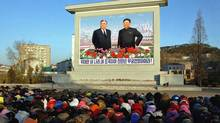 North Koreans mourn in front of a large portrait of Kim Jong Il and his father, Kim Il Sung, in a photo distributed Dec. 19, 2011 by the official Korean Central News Agency. (KNS/KNS/AFP/Getty Images)