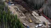 Crews work on a broken section of pipeline northeast of Peace River, Alta. (Ian Jackson/THE CANADIAN PRESS)
