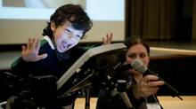 TORONTO: JUNE 8, 2013 - Joseph Spahn-Vieira, 5, uses technology to help him share a song he wrote during Breaking the ICE (Independence, Community and Empowerment) conference in Toronto on Saturday, June 8, 2013. Spahn-Vieira has cerebral palsy and has difficulty with speech and motor movements. (Matthew Sherwood/The Globe And Mail)
