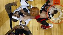 New Orleans Pelicans forward DeMarcus Cousins, top left, works under the basket against Toronto Raptors center Jonas Valanciunas, right, during the first half of an NBA basketball game in New Orleans, Wednesday, March 8, 2017. (Gerald Herbert/AP)