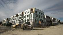 A new townhouse complex is under construction in Toronto on Thursday, November 3, 2016. Ontario will take steps next week to deal with rising house prices, but it will not follow British Columbia's lead and impose a tax on foreign buyers. (Nathan Denette/THE CANADIAN PRESS)