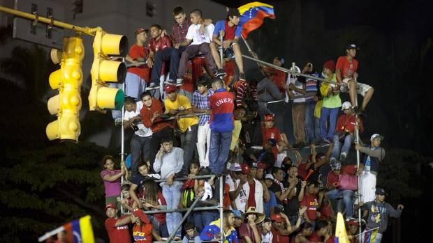 Venezuelan president Hugo Chavez scored a comfortable victory over opposition candidate Henrique Capriles Sunday, Oct. 7 2012. (Ramon Espinosa/AP)