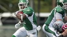 Saskatchewan Roughriders running back Kory Sheets runs the ball during first half CFL action against the Montreal Alouettes in Regina on Saturday, Aug. 17, 2013. (LIAM RICHARDS/THE CANADIAN PRESS)