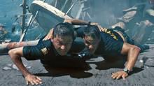 """Tadanobu Asano (left) and Taylor Kitsch in a scene from """"Battleship."""" (AP)"""