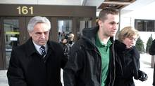 Former Premier of Newfoundland Brian Tobin, left, and wife Jodean Tobin escort their son Jack Tobin out of Ottawa court following his release on bond for $100,000 for being charged in the death of a man in a Christmas Eve accident in Ottawa. (Pawel Dwulit/The Canadian Press/Pawel Dwulit/The Canadian Press)