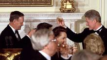 Prime Minister Jean Chretien, left, toasts U.S. President Bill Clinton during an official state dinner at the White House in 1997. The two leaders were known to be golfing buddies. (Win McNamee/REUTERS)