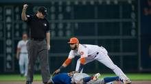 Toronto Blue Jays shortstop Jose Reyes (7) is tagged out and is injured while sliding into Houston Astros shortstop Marwin Gonzalez (9) during the first inning at Minute Maid Park. The Jays would go on to lose 6-1. (Jerome Miron/USA Today Sports)