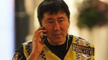 Vancouver Police Chief Jim Chu out on the streets in Vancouver, June 16, 2011. (JOHN LEHMANN/The Globe and Mail)