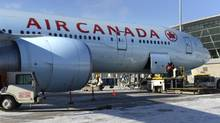 An Air Canada jet sits at the gate at Toronto's Pearson airport. (File) (Fred Lum/Fred Lum/The Globe and Mail)