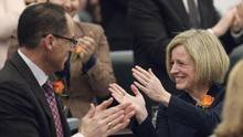 Alberta Finance Minister Joe Ceci and Premier Rachel Notley applaud after the speech from the throne. (JASON FRANSON/THE CANADIAN PRESS)