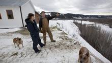 Arlene Boon, whose grandfather bought the family property along the Peace River outside of Fort St. John, and her husband Ken look over their property on January 16, 2013. (Deborah Baic/The Globe and Mail)