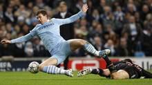 Manchester City's Edin Dzeko is challenged by Bayern Munich's Diego Contento during their Champions League Group A soccer match. (DARREN STAPLES/Reuters)