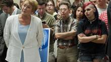 Parti Quebecois leader Pauline Marois waits to be introduced prior to making a speech during an election campaign stop at a CEGEP in Saint-Hyacinthe, Que., Thursday, August 30, 2012. (Graham Hughes/THE CANADIAN PRESS)