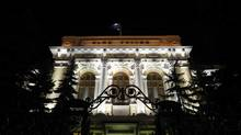 A view of the Russian central bank at night in Moscow. (DENIS SINYAKOV/REUTERS)