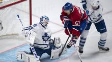 Montreal Canadiens' Max Pacioretty jumps as he tries to deflect a shot past Toronto Maple Leafs goalie Jonathan Bernier with defenseman Dion Phaneuf behind during first period NHL action Saturday, November 30, 2013 in Montreal. (CP)