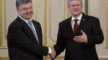 Ukranian President Peter Poroshenko meets with Canadian Prime Minister Stephen Harper several hours after Poroshenko was sworn in June 7 in Kiev. (Adrian Wyld/THE CANADIAN PRESS)