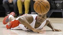 Toronto Raptors' Kyle Lowry lies on the court after being fouled by Milwaukee Bucks' Brandon Knight during first half NBA basketball action in Toronto on Monday, April 14, 2014. (Chris Young/THE CANADIAN PRESS)