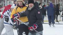 Montreal Canadiens defenceman Josh Gorges, right, watches the play during a game of pick-up hockey in Montreal, Wednesday, December 26, 2012. Gorges used Twitter to organize a Boxing Day outdoor hockey game with fans at a neighbourhood rink in Montreal. (Graham Hughes/THE CANADIAN PRESS)
