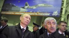 Russia's Prime Minister Vladimir Putin, left, visits an aircraft production workshop with Mikhail Pogosyan, president of United Aircraft Corp., in Komsomolsk-on-Amur in Russia's Far East, on Feb. 20, 2012. (Alexsey Druginyn/RIA Novosti/Pool/Reuters/Alexsey Druginyn/RIA Novosti/Pool/Reuters)