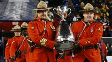 The Grey Cup is carried by members of the Royal Canadian Mounted Police prior to the start of the 103rd Grey Cup championship game between the Ottawa Redblacks and Edmonton Eskimos on Nov. 29. (MARK BLINCH/REUTERS)