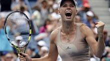 Caroline Wozniacki of Denmark celebrates her win over Maria Sharpova at the 2014 U.S. Open tennis tournament in New York, August 31, 2014. (RAY STUBBLEBINE/REUTERS)