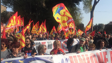 Union members who support the reborn Italian Communist party protesting Italy's EU and NATO membership and use of the euro at a street rally hours after the EU leaders celebrated the 60th anniversary of signi«g of the Treaty of Rome. (Eric Reguly/The Globe and Mail)