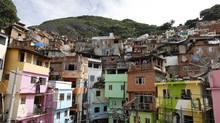 Residents paint buildings at the Dona Marta slum in Rio de Janeiro, Brazil, April 1, 2010. (Felipe Dana/The Associated Press)